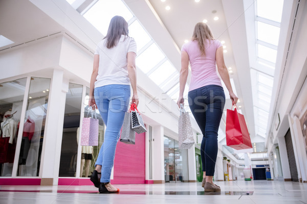 Rear view of women walking in mall with shopping bags Stock photo © wavebreak_media