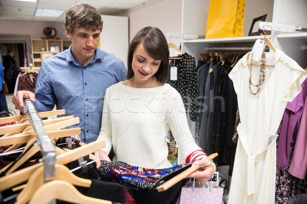 Couple selecting a dress while shopping for clothes Stock photo © wavebreak_media
