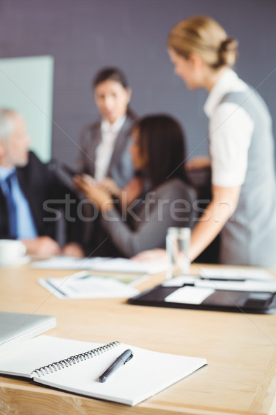 Organizer with pen on table in conference room Stock photo © wavebreak_media