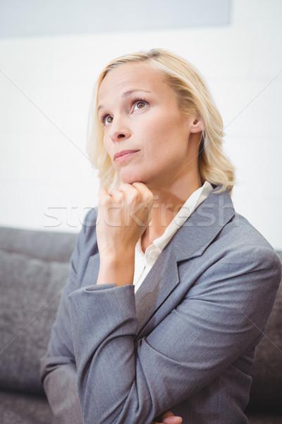 деловая женщина стороны подбородок сидят служба Сток-фото © wavebreak_media