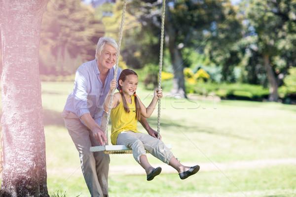 Nagyapa toló leányunoka hinta park lány Stock fotó © wavebreak_media