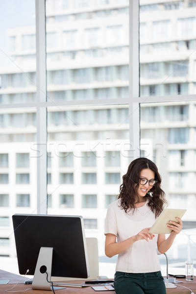 a businesswoman is using her pad in her office Stock photo © wavebreak_media