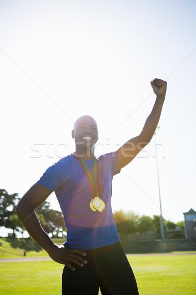 Athleten posiert Goldmedaille Sieg läuft Länge Stock foto © wavebreak_media