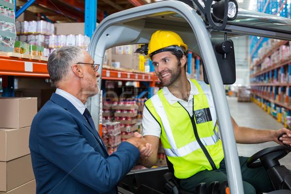 Worker handshaking with well dressed senior person Stock photo © wavebreak_media
