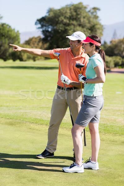 счастливым гольфист человека указывая Постоянный женщину Сток-фото © wavebreak_media