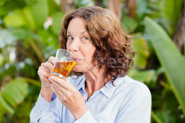 Portrait of mature woman drinking herbal tea Stock photo © wavebreak_media