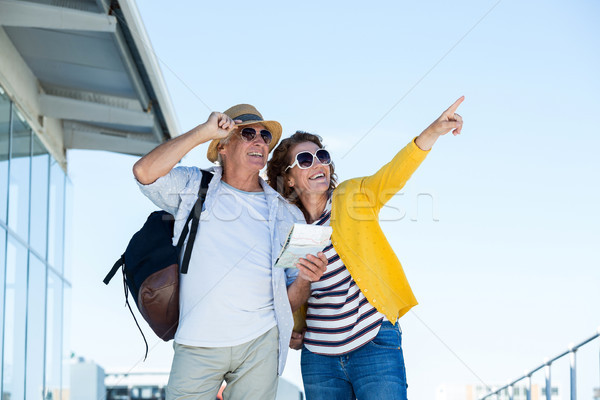 Happy couple with sunglasses standing against clear sky Stock photo © wavebreak_media