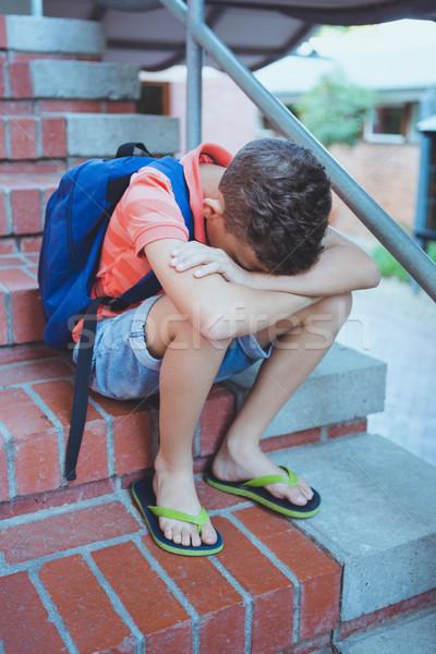üzücü öğrenci oturma tek başına merdiven okul Stok fotoğraf © wavebreak_media