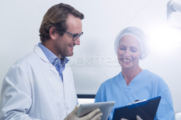 Dentist and dental assistant working on digital tablet Stock photo © wavebreak_media