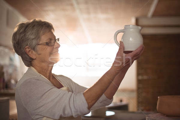 Female potter checking jug Stock photo © wavebreak_media