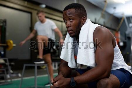 Portrait of smiling hipster holding tablet in gym Stock photo © wavebreak_media