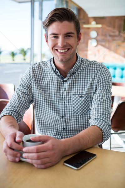 Ritratto sorridere uomo seduta coffee shop Cup Foto d'archivio © wavebreak_media
