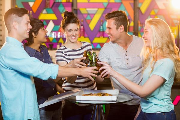 Csoport barátok pirít üveg sör mosolyog Stock fotó © wavebreak_media