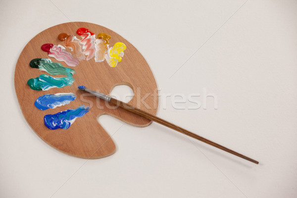 Palette with multiple colors and paint brushes Stock photo © wavebreak_media