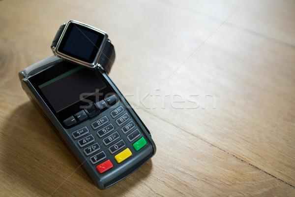 Smart watch and credit card reader on table in coffee shop Stock photo © wavebreak_media