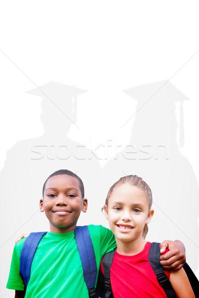 Composite image of cute pupils smiling at camera  Stock photo © wavebreak_media