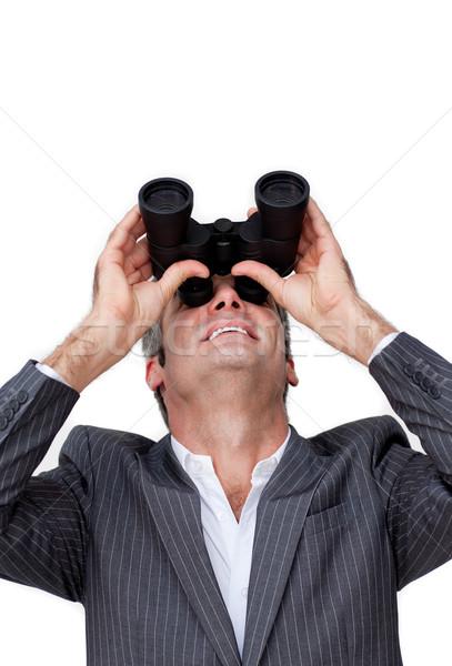 Positive Businessman looking up through a pair of binoculars  Stock photo © wavebreak_media