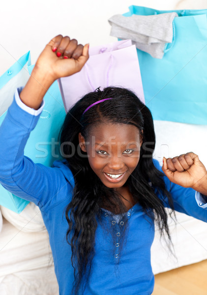 Stock photo: Happy woman punching the air in celebration after shopping