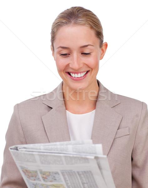 Confident businesswoman reading a newspaper  Stock photo © wavebreak_media