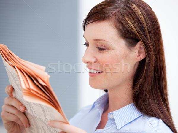 Smiling businesswoman reading newspaper Stock photo © wavebreak_media