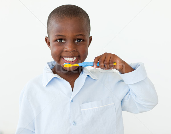 Portrait of a smiling little boy brushing his teeth Stock photo © wavebreak_media