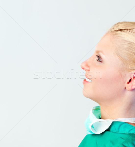 Femminile chirurgo maschera guardando medico Foto d'archivio © wavebreak_media