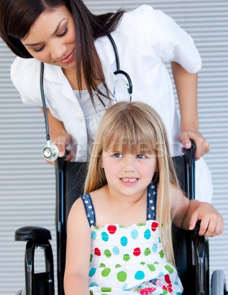 Smiling cute girl sitting on the wheelchair Stock photo © wavebreak_media