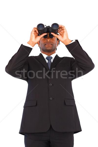Serious businessman manager using binoculars Stock photo © wavebreak_media