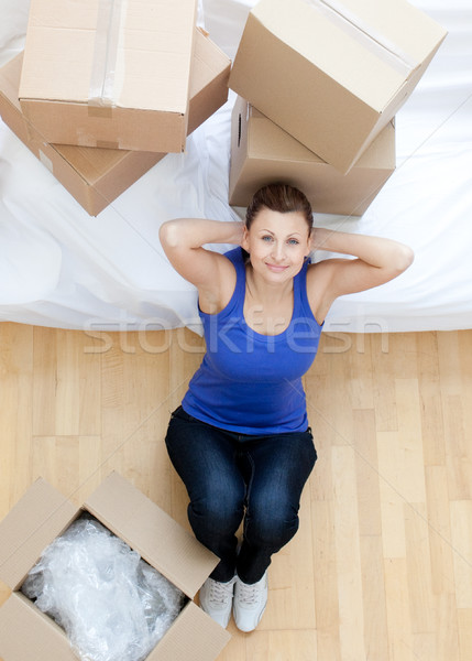Relaxed woman sitting between boxes at home Stock photo © wavebreak_media
