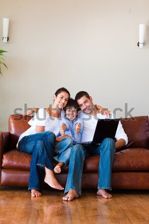 Cute boy plays with his parents video games in the living room Stock photo © wavebreak_media