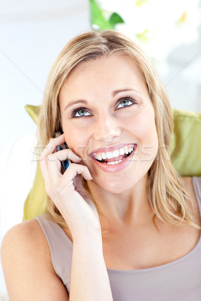 Animated caucasian woman talking on phone in the living room Stock photo © wavebreak_media