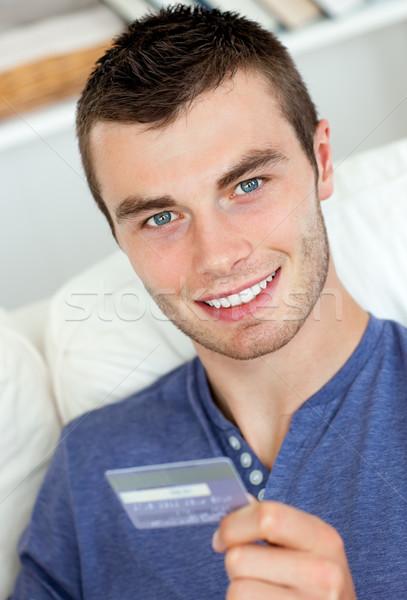 Gioioso uomo carta sorridere fotocamera Foto d'archivio © wavebreak_media