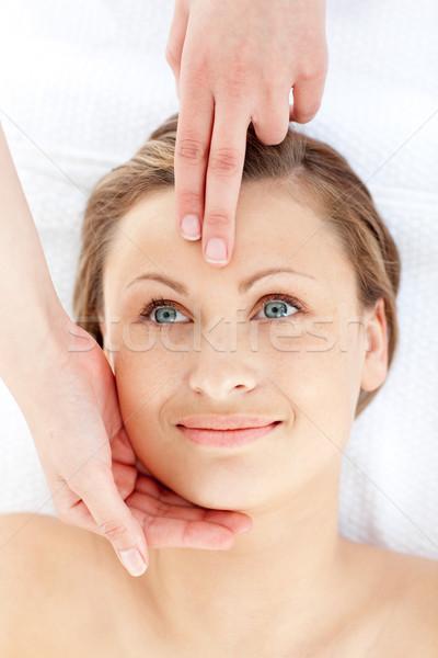 Glowing young woman having a head massage in a health spa Stock photo © wavebreak_media