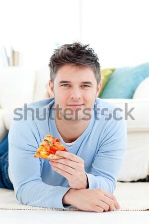 привлекательный молодым человеком еды хлеб сидят кухне Сток-фото © wavebreak_media