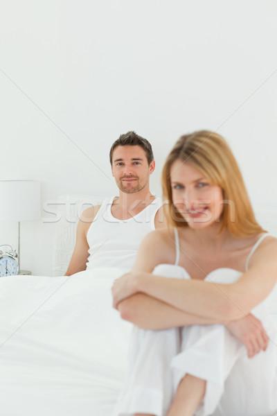 Femme regarder caméra mari maison sourire Photo stock © wavebreak_media