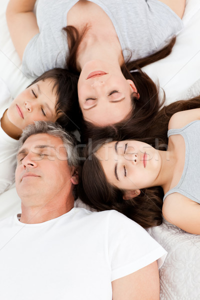 Family lying down on their bed at home Stock photo © wavebreak_media