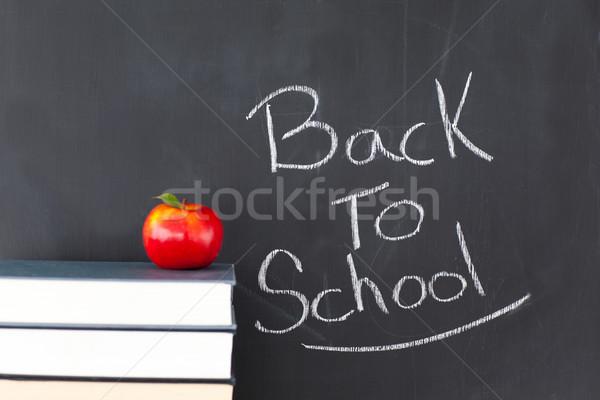 Books an apple and a blackboard Stock photo © wavebreak_media