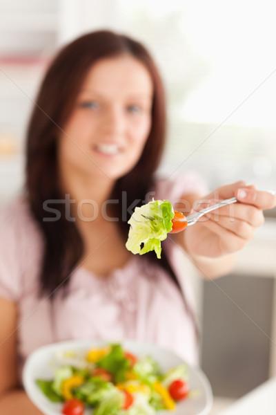 Kadın salata çatal ev gülümseme Stok fotoğraf © wavebreak_media