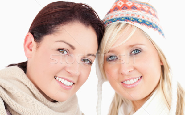 Stock photo: Two pretty women with heads together looking to camera