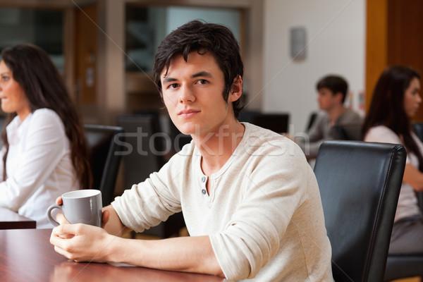Man having a coffee in a cafe Stock photo © wavebreak_media