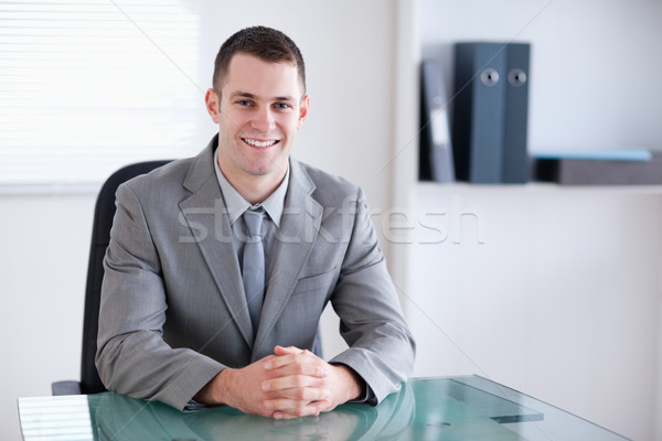 Smiling businessman sitting behind a table in a meeting Stock photo © wavebreak_media