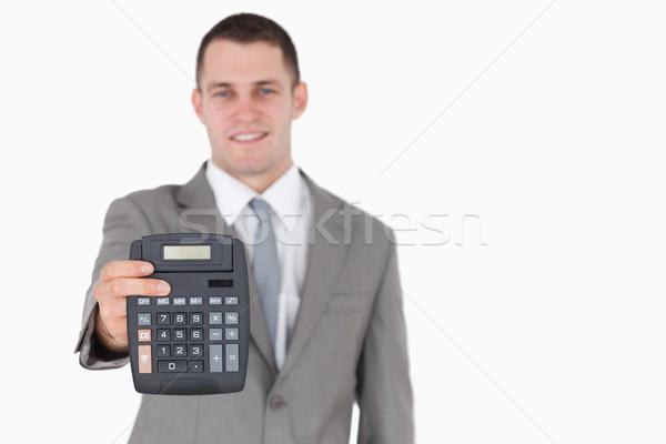 Businessman showing a calculator against a white background Stock photo © wavebreak_media