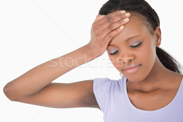 Közelkép fiatal nő tart homlok fehér háttér Stock fotó © wavebreak_media