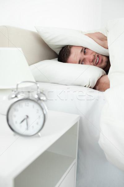 Ritratto infelice uomo orecchie cuscino sveglia Foto d'archivio © wavebreak_media