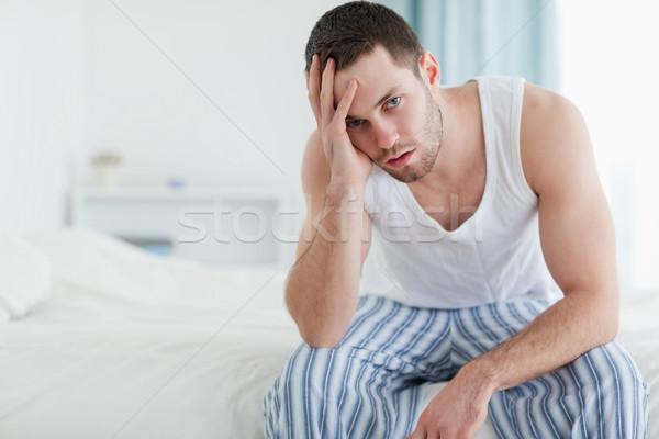 Bunalımlı adam oturma yatak bakıyor kamera Stok fotoğraf © wavebreak_media
