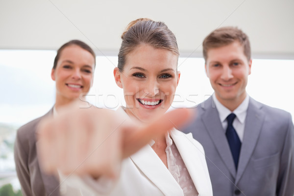HR Manager with team behind her about to give thumb up Stock photo © wavebreak_media