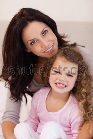 Young mother embracing her daughter Stock photo © wavebreak_media
