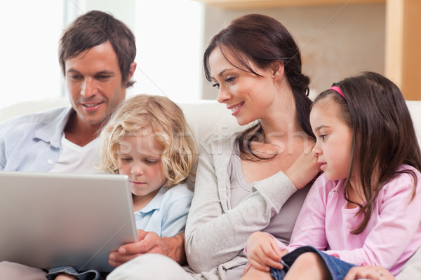 Serene family using a notebook in a living room Stock photo © wavebreak_media