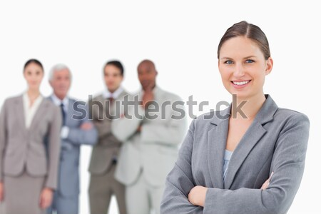 Smiling tradeswoman with folded arms and colleagues behind her against a white background Stock photo © wavebreak_media
