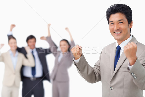 Successful businessman getting celebrated by colleagues against a white background Stock photo © wavebreak_media